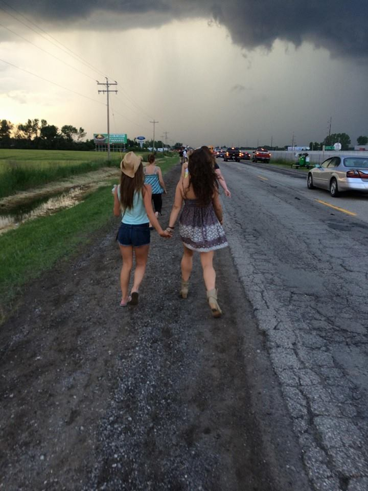 girls running down a country road
