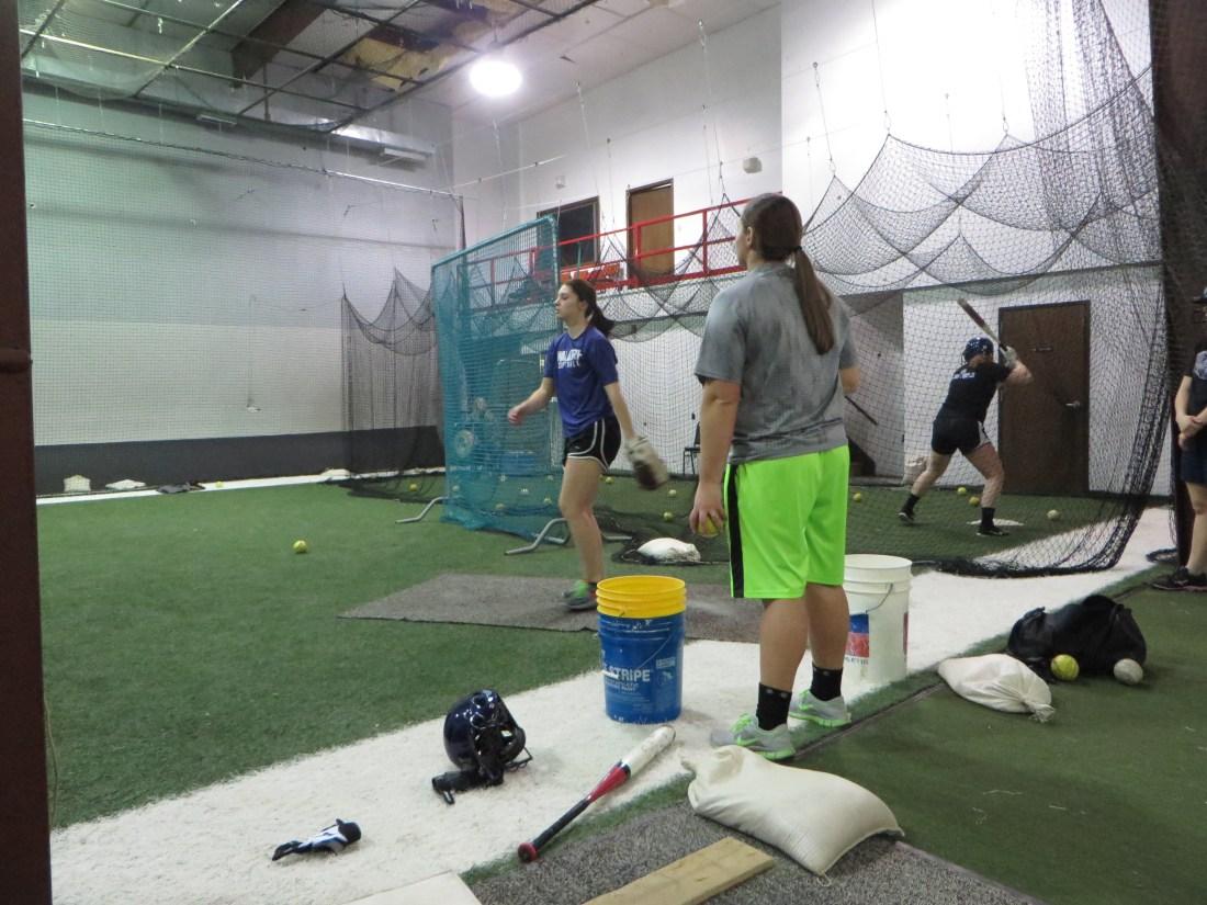 girls playing softball in indoor gym DJACC