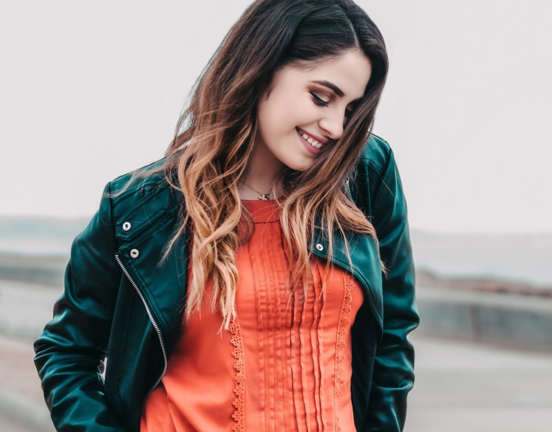 girl smiling and looking down