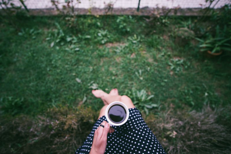 learn to be alone, happy alone, person holding coffee