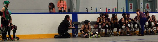 E-Val stares down the opposing team from the penalty box.