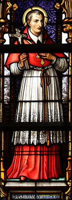 A stained-glass window featuring Saint Charles Borromeo.