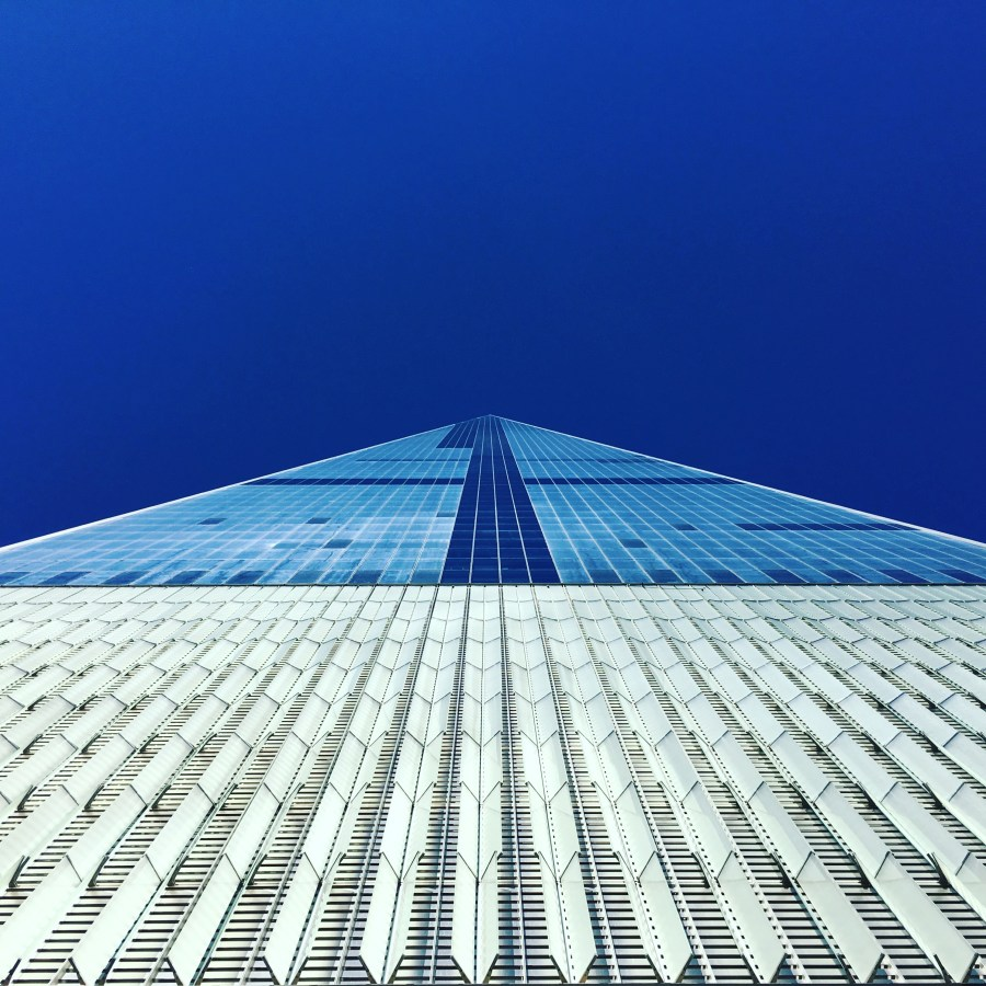Looking up at skyscraper from ground