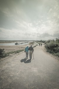 Old couple walking hand in hand