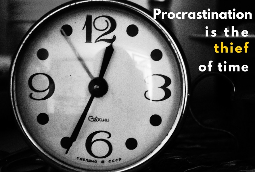 clock with proverb: Procrastination is the thief of time