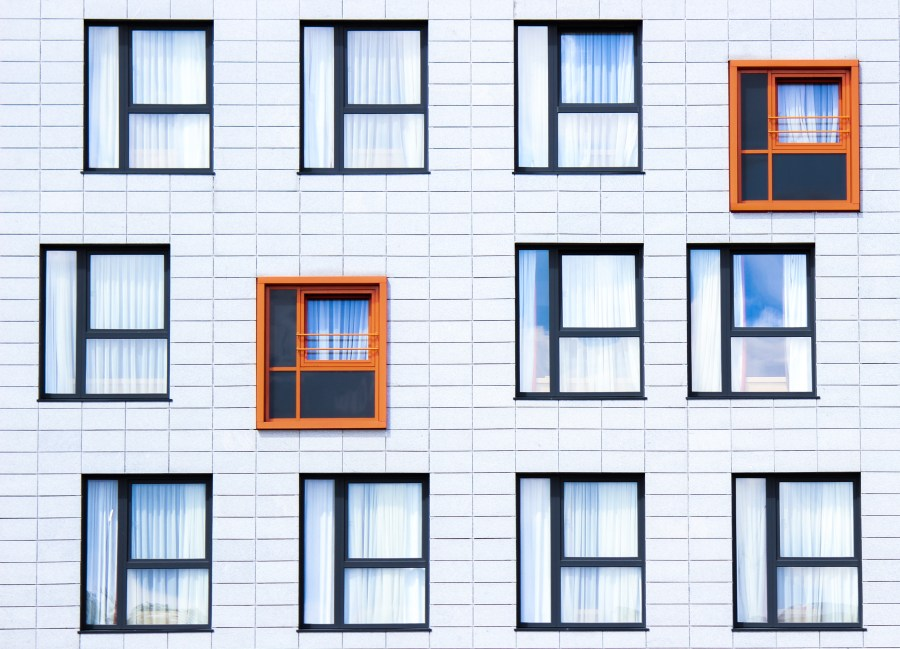 windows in a building, 2 orange the rest black