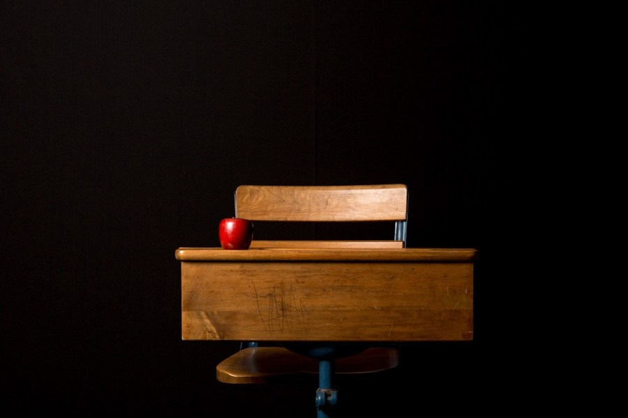 Picture of school desk with apple on it