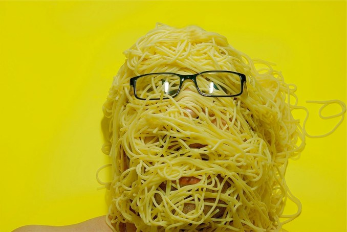 pasta covering face