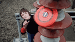 boy attempting to retrieve frisbee from pylons