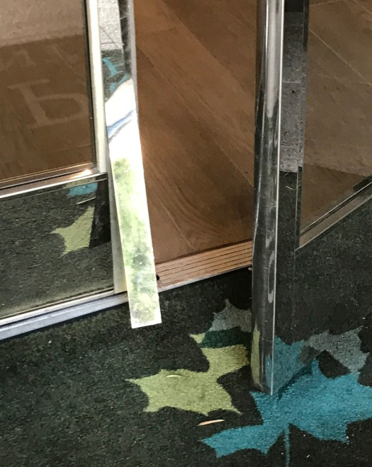 Closeup of Damaged Lobby Door