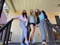 Caitlyn Devine '22, Cassie McCabe '22, and Emmaline Kremsky '22 pose in front of their off-campus house on Sept. 20 2020 (Kate Brady)