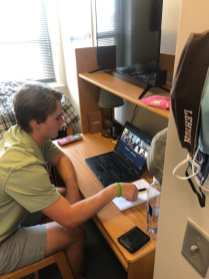 Aidan gets ready for his Spanish zoom class on Monday Sept. 28, 2020 in his dorm room of Farrington Square at Lehigh University in Bethlehem, Pennsylvania. Aidan is currently in the College of Arts and Sciences and is working toward an Economics major. (J24/Cole Kirst)