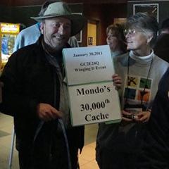 Mondo with a congratulatory 30K cache card