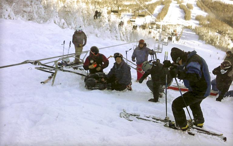 chair lift accident flip and fold high authorities investigating radio boston skiers attending a skier who fell onto the slope after derailed on