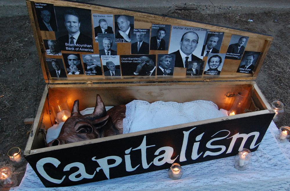 Mock coffin prop used in the 'Funeral March for Capitalism.' (Greg Cook)