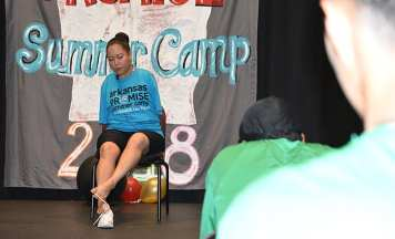 Jessica Cox demonstrates how she ties her shoes, a chore she learned when she was 6 years old.