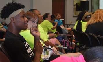 A PROMISE participant enjoys a speaker's talk.
