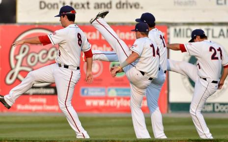 Players stretch before a Minor League Baseball game.