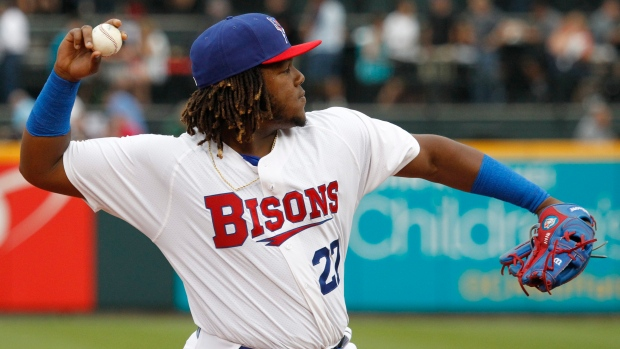 Vladimir Guerrero Jr. throwing a ball while with the Buffalo Bisons.