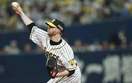 Pierce Johnson delivers a pitch for the Hanshin Tigers.