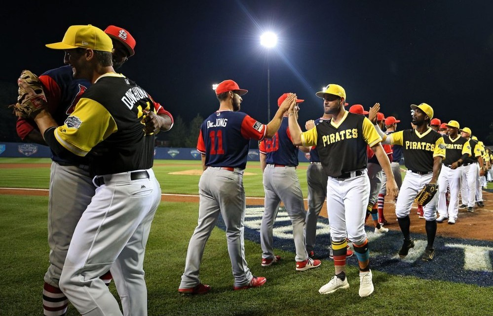Pirates and Cardinals shaking hands after the 2017 Little League Classic