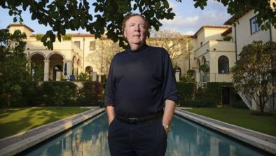James Patterson outside his mansion