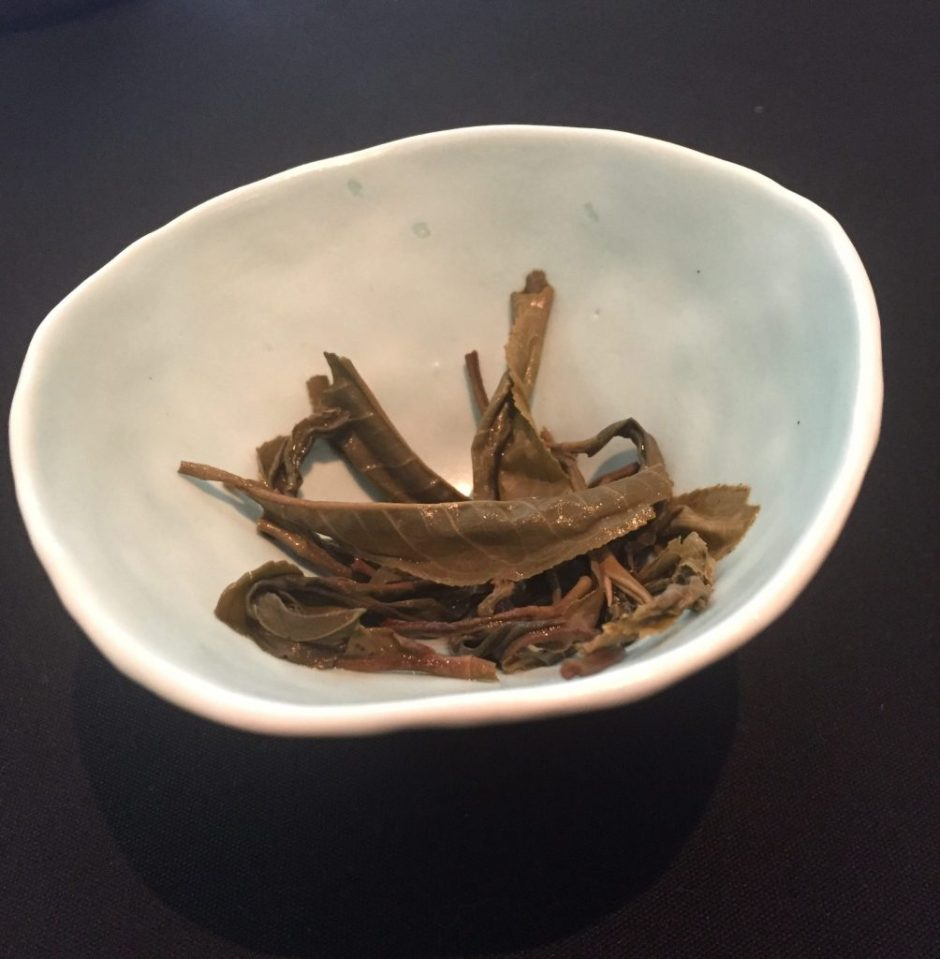 tea cup with leaves in it