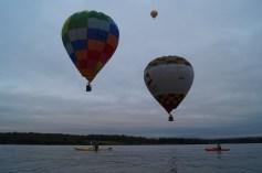 Kayaking beneath balloons, landscape