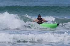 Nick surf kayaking, brace