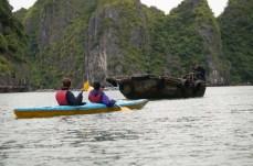 Paddling by a boat, Lan Ha Bay