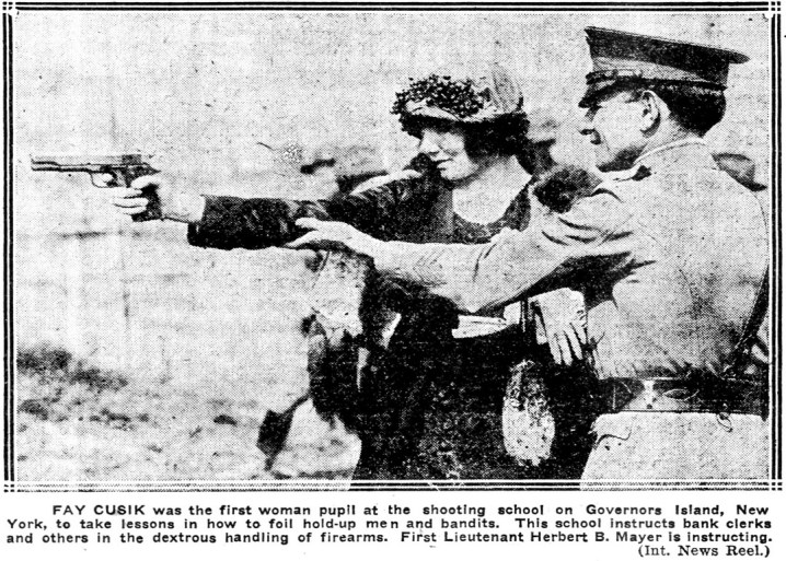 Fay Cusik, first woman pupil at Governors Island, NY shooting school. (1922)