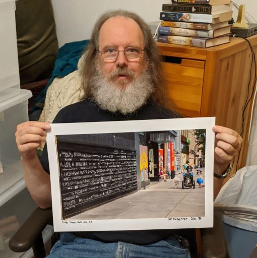 "Me holding 13x19 print of ""Blackboard"""