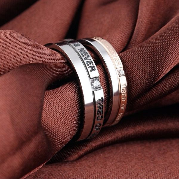 'Love is never tired of waiting' Stainless Steel Couple Rings