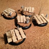 Cork Tile, old paint brush reeds  and coffee stirrers