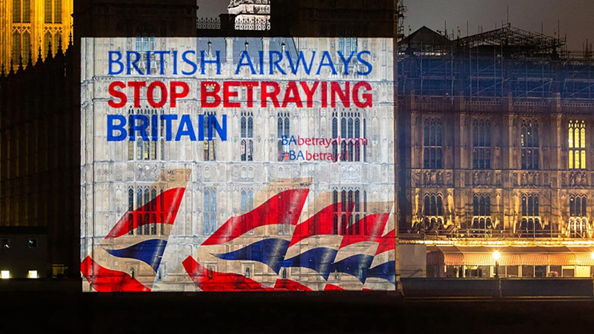 Slide projected onto the Houses of Parliament reads: British Airways, stop betraying Britain