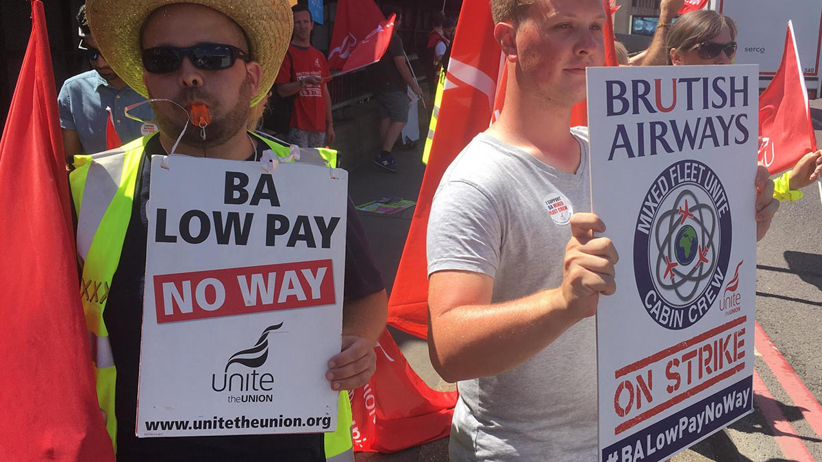 British Airways strike placards read 'Low pay no way'