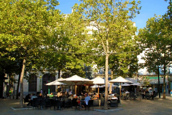 Tree-lined squares with cafes