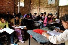 Muyein's English class is silent, as students concentrate hard on their work.