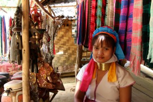 In northern Thailand, 21-year-old Mapaung awaits the now-infrequent visits from tourists, who she depends upon for income.