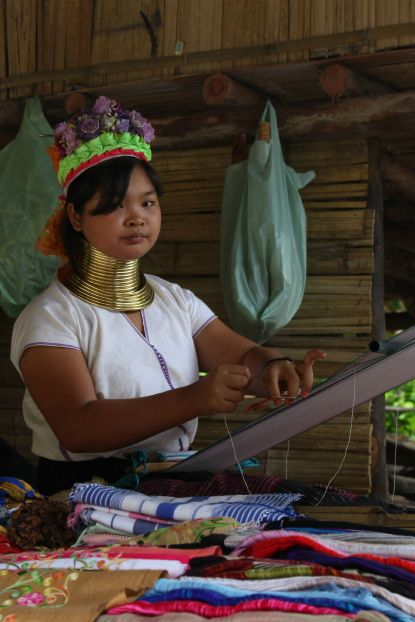 Just outside of Chiang Mai, women kept in 'tribal villages' for the convenience of tourists weave everything they sell on traditional wooden looms, enforcing their 'tribal' image.