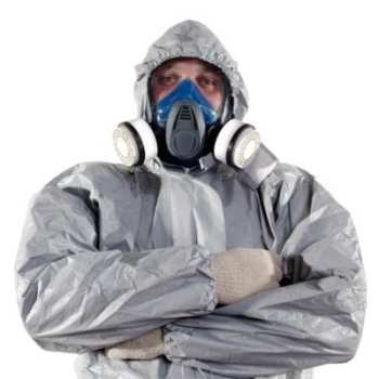 Shows a fully suited worker with protective overwear and full face fitted mask