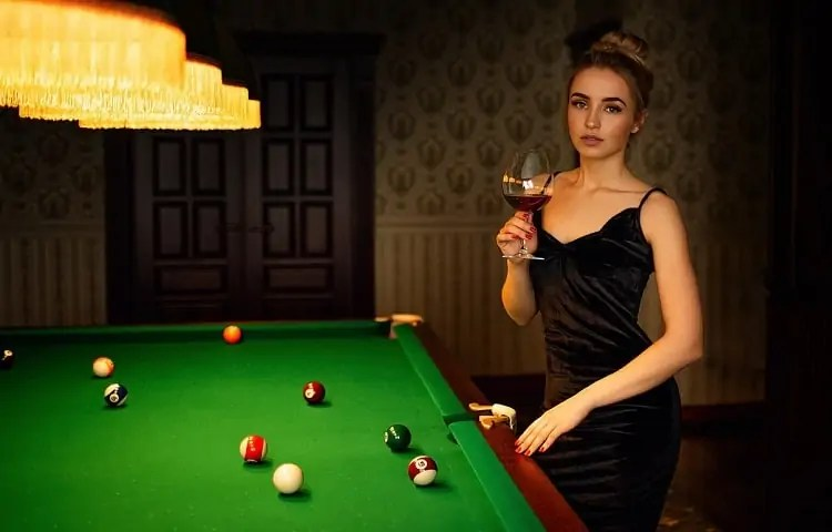 beautiful girl by the pool table