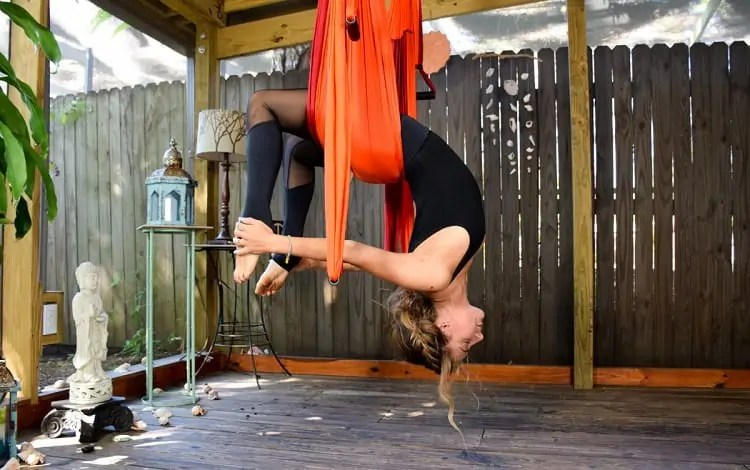 hanging upside down with a yoga trapeze set