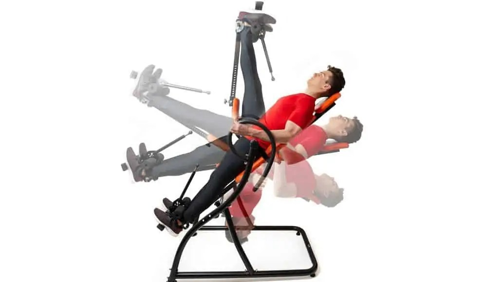man decompressing spine on inversion table