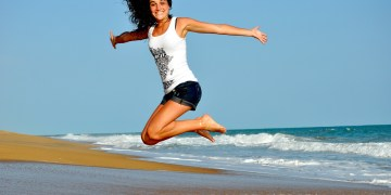 Happy girl on the beach during her periods