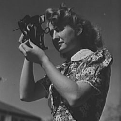 A young woman using a sextant to illustrate the idea of setting targets to create a good workplace culture