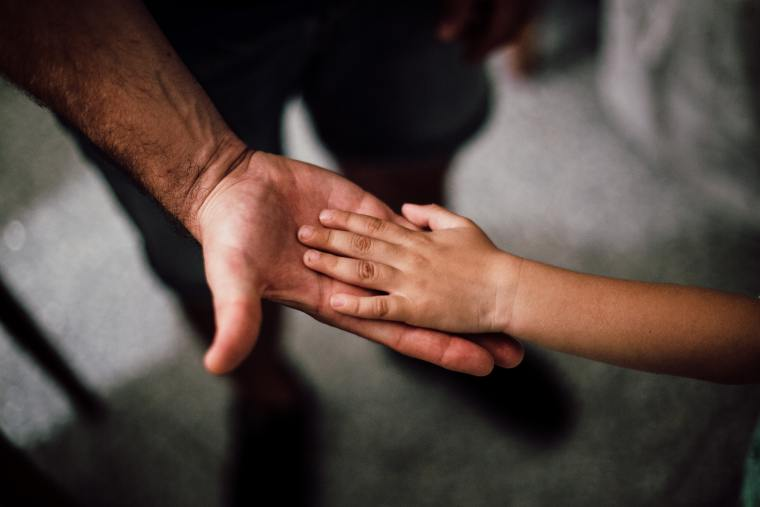 Fathers face stigma for parenting their children.