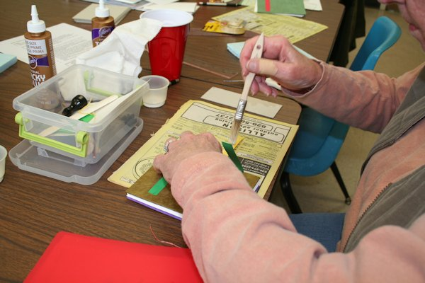 Pasting up a book in workshop by Susi Hall