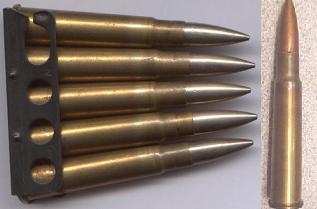 .303 British cartridge with Mk.VII bullet in charger clip and alone.