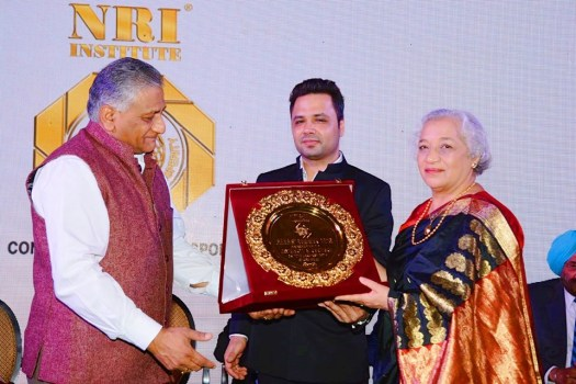 Photo of author and activist Jaya Kamlani receiving the NRI Institute's Bharat Samman (Pride of India) award from former Army Chief, General V K Singh, Minister of State for External Affairs and Manu Jagmohan Singh, Secretary General of NRI Institute on January 12 at the Leela Palace, Delhi.